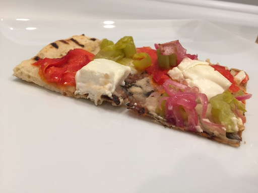 Grilled Pizza w/ Smoked Salmon, White Bean Puree, Pickled Pepper & Onion, and Goat Cheese